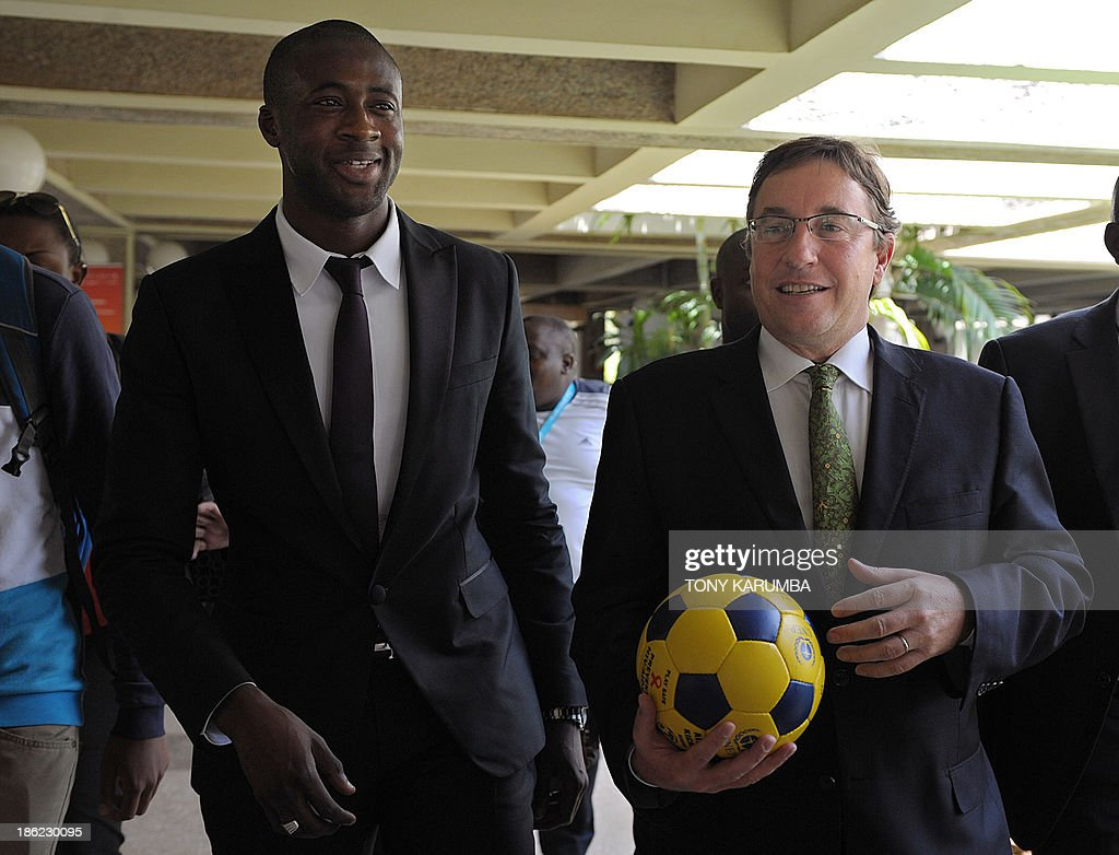 Ivory Coast's football player Yaya Toure (L) leaves with UNEP executive Director Achim Steiner following a press conference where he was appointed the United Nations Environment Program goodwill ambassador at the UNEP headquarters in the Kenyan capital Nairobi on October 29, 2013. Toure, African Footballer of the Year Toure and star of Manchester City, warned that the slaughter of elephants for their ivory was threatening their very existence as he was appointed UNEP ambassador.