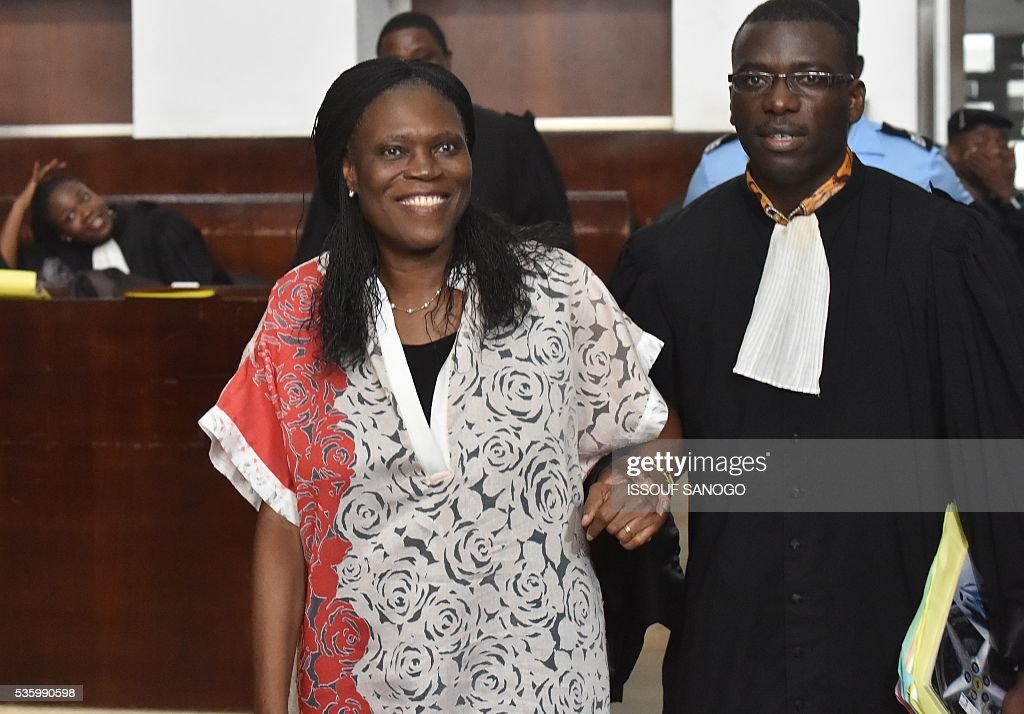 Ivory Coast's former first lady Simone Gbagbo arrives for her trial at the Abidjan Justice Court on May 31, 2016. Simone Gbagbo goes on trial for crimes against humanity, but rights groups acting as plaintiffs in the case have pulled out, blasting the proceedings as flawed. / AFP / ISSOUF