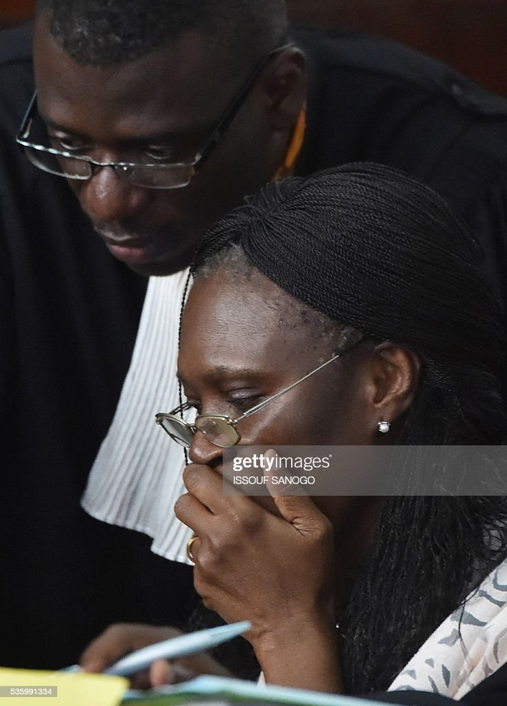 Ivory Coast's former first lady Simone Gbagbo attends her trial at the Abidjan Justice Court on May 31, 2016. Simone Gbagbo goes on trial for crimes against humanity in what many see as a litmus case for justice in the west African country. The hearings into the 66-year-old's role in post-election carnage in 2010 is expected to last a month with 32 witnesses testifying. SANOGO