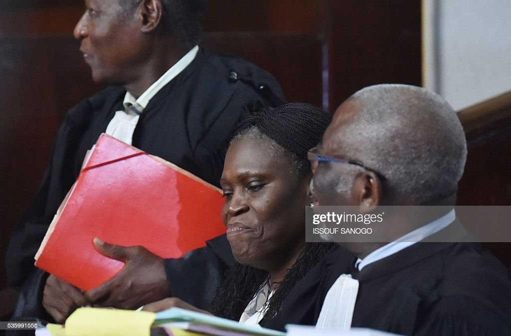 Ivory Coast's former first lady Simone Gbagbo (C) attends her trial at the Abidjan Justice Court on May 31, 2016. Simone Gbagbo goes on trial for crimes against humanity in what many see as a litmus case for justice in the west African country. The hearings into the 66-year-old's role in post-election carnage in 2010 is expected to last a month with 32 witnesses testifying. SANOGO