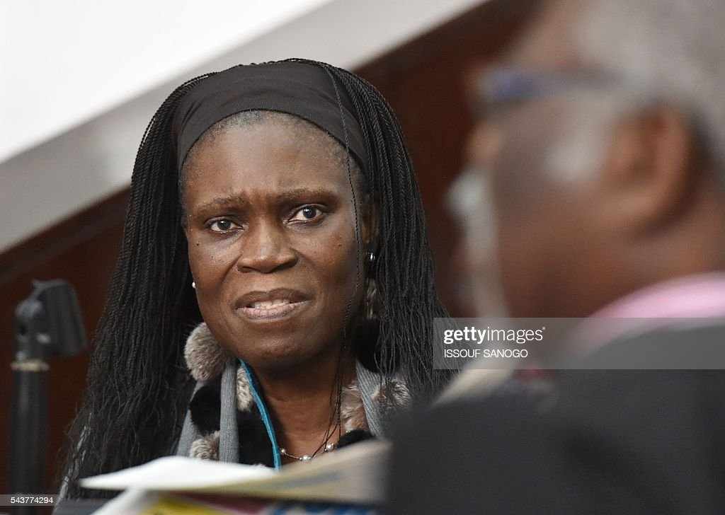 Ivory Coast's former first lady Simone Gbagbo looks on as she attends her trial on June 30, 2016, at the appeal court in Abidjan. An ex-militia chief in Ivory Coast said on June 27, 2016 at the trial of Simone Gbagbo for crimes against humanity that the former first lady had financed the movement. Simone Gbagbo faces allegations of crimes against prisoners of war, crimes against the civilian population and crimes against humanity. / AFP / ISSOUF