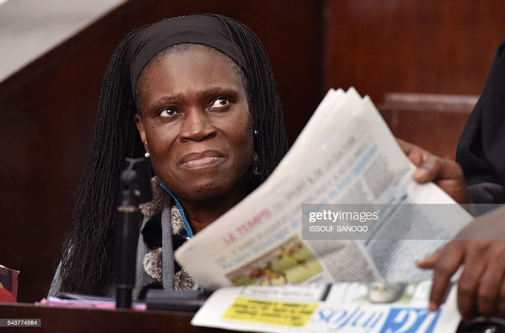 Ivory Coast's former first lady Simone Gbagbo looks on during her trial on June 30, 2016 at the appeal court in Abidjan. An ex-militia chief in Ivory Coast said on June 27, 2016 at the trial of Simone Gbagbo for crimes against humanity that the former first lady had financed the movement. Simone Gbagbo faces allegations of crimes against prisoners of war, crimes against the civilian population and crimes against humanity. / AFP / ISSOUF