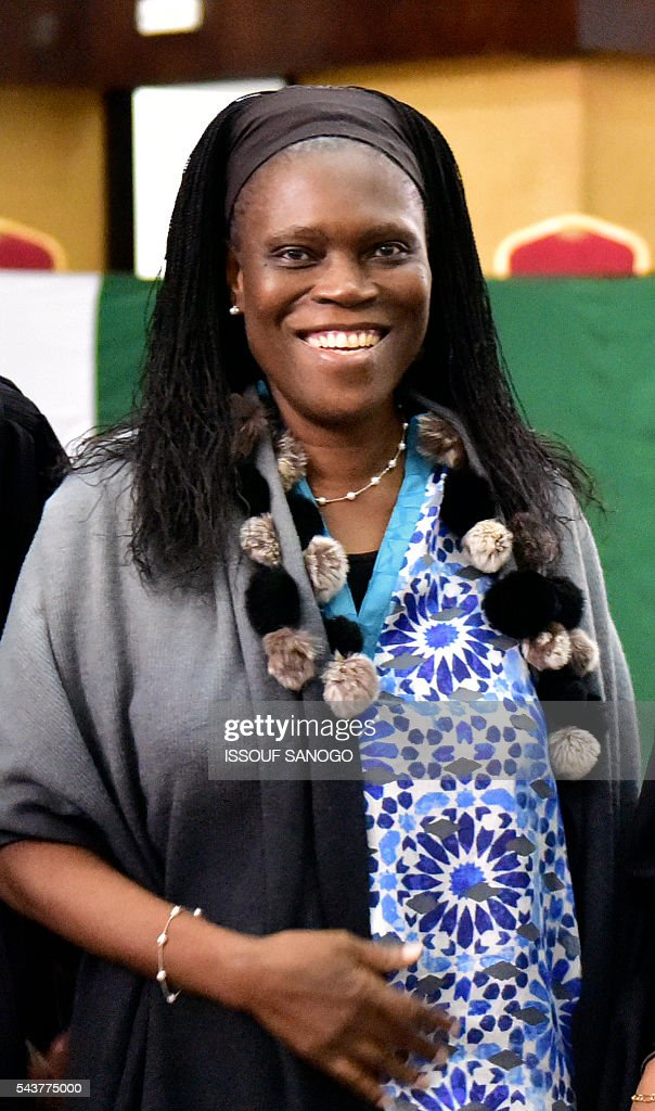 Ivory Coast's former first lady Simone Gbagbo pose as she attends her trial on June 30, 2016, at the appeal court in Abidjan. An ex-militia chief in Ivory Coast said on June 27, 2016 at the trial of Simone Gbagbo for crimes against humanity that the former first lady had financed the movement. Simone Gbagbo faces allegations of crimes against prisoners of war, crimes against the civilian population and crimes against humanity. / AFP / ISSOUF