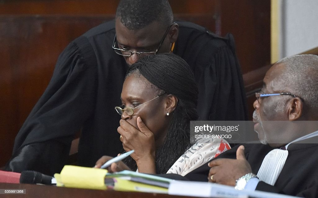 Ivory Coast's former first lady Simone Gbagbo speaks with her lawyers during her trial at the Abidjan Justice Court on May 31, 2016. Simone Gbagbo goes on trial for crimes against humanity in what many see as a litmus case for justice in the west African country. The hearings into the 66-year-old's role in post-election carnage in 2010 is expected to last a month with 32 witnesses testifying. SANOGO