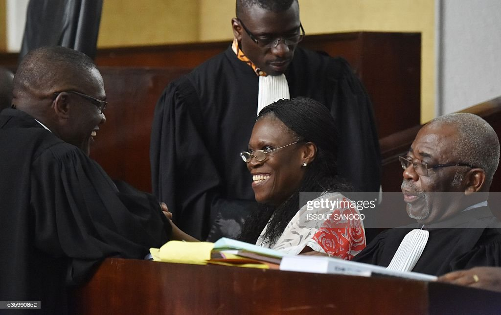 Ivory Coast's former first lady Simone Gbagbo speaks with lawyers during her trial at the Abidjan Justice Court on May 31, 2016. Simone Gbagbo goes on trial for crimes against humanity in what many see as a litmus case for justice in the west African country. The hearings into the 66-year-old's role in post-election carnage in 2010 is expected to last a month with 32 witnesses testifying. SANOGO