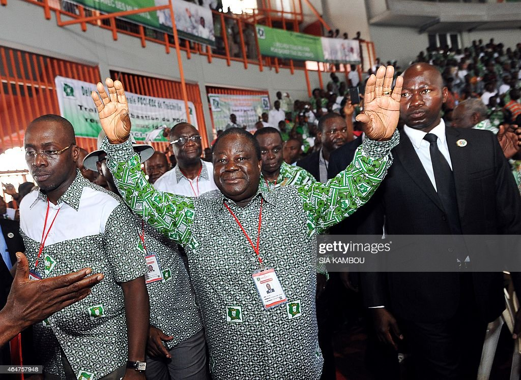 Ivory Coast's former president <a gi-track='captionPersonalityLinkClicked' href=/galleries/search?phrase=Henri+Konan+Bedie&family=editorial&specificpeople=697544 ng-click='$event.stopPropagation()'>Henri Konan Bedie</a> (C), leader of the Democratic Party of Ivory Coast (PDCI), waves as he arrives at the fifth PDCI congress on February 28, 2015 in Abidjan. The PDCI, allied with Ivory Coast's president Alassane Ouattara, decided to not present a candidate for Ivory Coast's presidential election of October 2015, in favour of a unique candidacy backing Ouattara.
