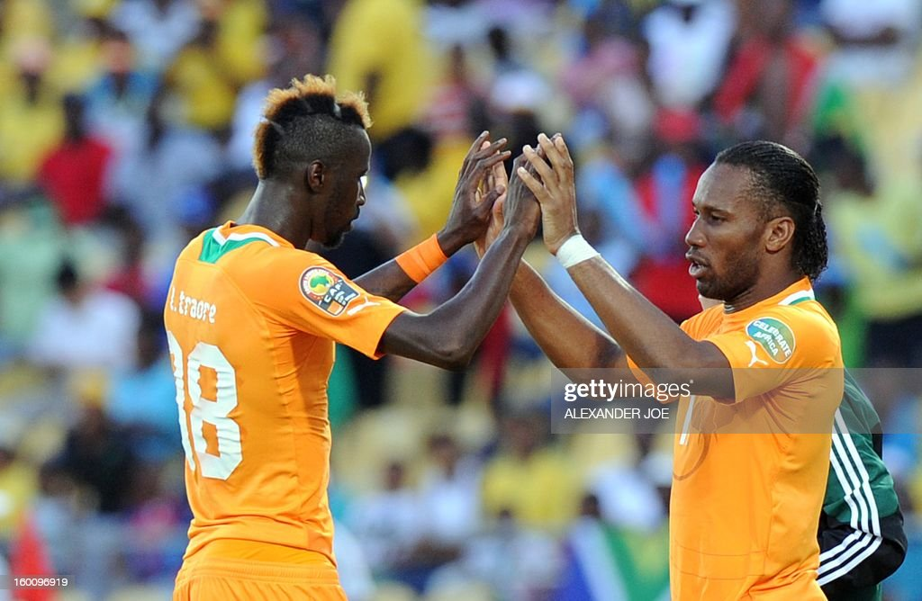 Ivory Coast's forward Didier Drogba (R) celebrates with Ivory Coast forward Lacina Traore during the 2013 African Cup of Nations in Rustenburg on January 26, 2013 at Royal Bafokeng Stadium in a Group D match. AFP PHOTO / ALEXANDER JOE