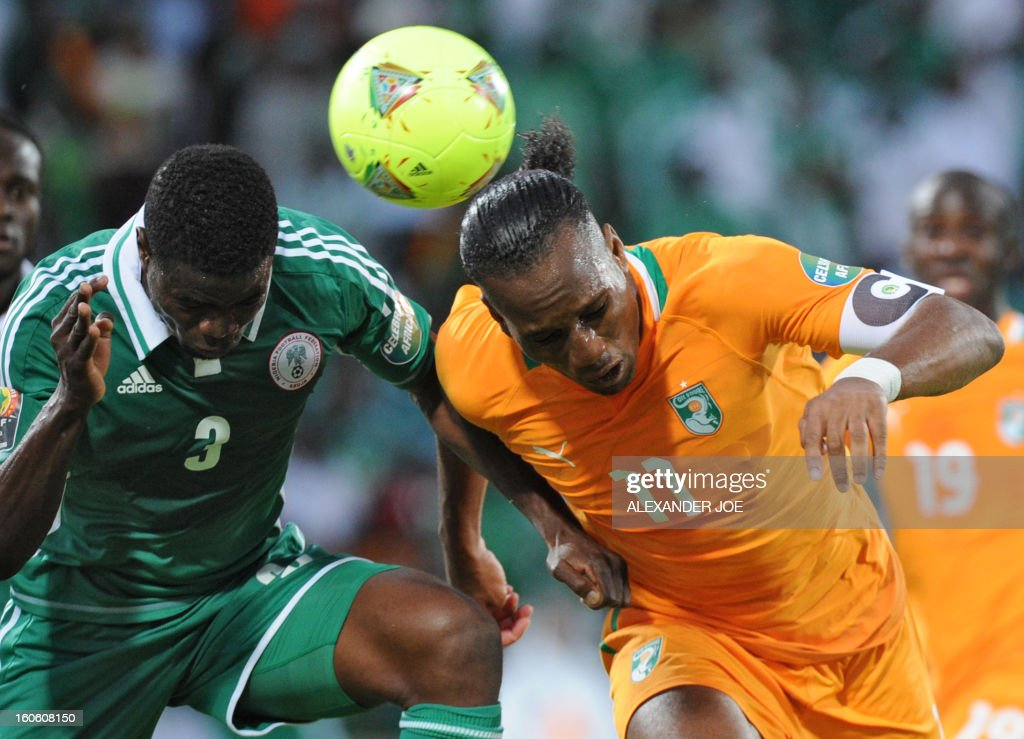 Ivory Coast's forward Didier Drogba (R) heads the ball in front of Nigeria's defender Elderson Echiejile (L) during the African Cup of Nation 2013 quarter final football match Ivory Coast vs Nigeria, on February 3, 2013 in Rustenburg.