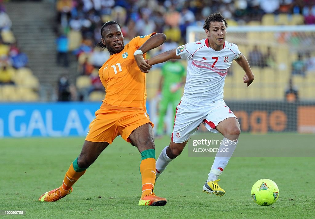 Ivory Coast's forward Didier Drogba (L) vies with Tunisia's Midfielder Youssef Msakni during the 2013 African Cup of Nations football match Ivory Coast vs Tunisia in Rustenburg on January 26, 2013 at Royal Bafokeng Stadium. Ivory Coast won 3-0.