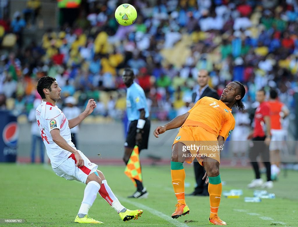 Ivory Coast's forward Didier Drogba (L) vies with Tunisia's midfielder Mejdi Traoui during the 2013 African Cup of Nations football match Ivory Coast vs Tunisia in Rustenburg on January 26, 2013 at Royal Bafokeng Stadium. Ivory Coast won 3-0.
