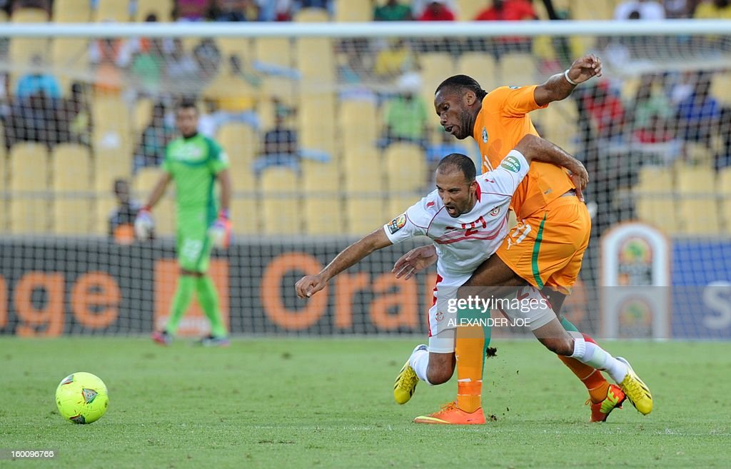 Ivory Coast's forward Didier Drogba (L) vies with Tunisia's Midfielder Khaled Mouelhi during the 2013 African Cup of Nations football match Ivory Coast vs Tunisia in Rustenburg on January 26, 2013 at Royal Bafokeng Stadium. Ivory Coast won 3-0.