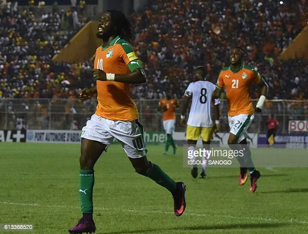Ivory Coast's forward Gervinho and Jonathan Kodjia celebrate after scoring during the World Cup 2018 football qualification match between Ivory Coast...