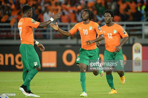 Ivory Coast's forward Gervinho celebrates with Ivory Coast's defender Serge Aurier and Ivory Coast's forward Wilfried Bony after scoring his team's...