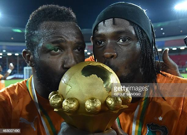 Ivory Coast's forward Gervinho kisses the trophy at the end of the 2015 African Cup of Nations final football match between Ivory Coast and Ghana in...
