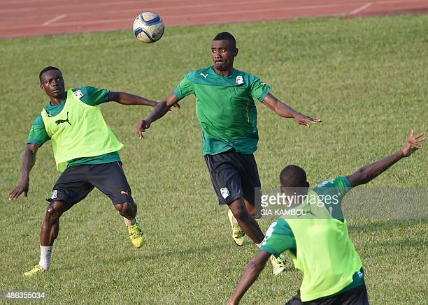 Ivory Coast's forward Salomon Kalou vies for the ball with Ivory Coast's midfielder Ismael Diomande during a training session on September 3 2015 at...