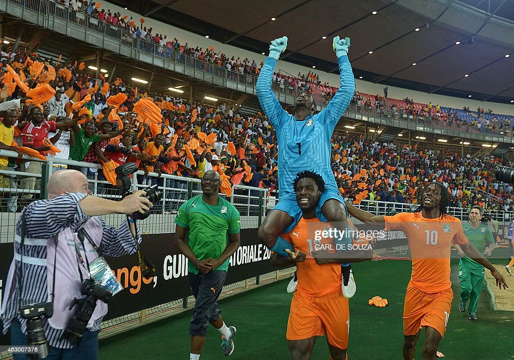 Ivory Coast's forward <a gi-track='captionPersonalityLinkClicked' href=/galleries/search?phrase=Wilfried+Bony&family=editorial&specificpeople=4231248 ng-click='$event.stopPropagation()'>Wilfried Bony</a> (2nd-R) carries goalkeeper <a gi-track='captionPersonalityLinkClicked' href=/galleries/search?phrase=Boubacar+Barry&family=editorial&specificpeople=550738 ng-click='$event.stopPropagation()'>Boubacar Barry</a> on his shoulders as they celebrate with forward <a gi-track='captionPersonalityLinkClicked' href=/galleries/search?phrase=Gervinho&family=editorial&specificpeople=4500752 ng-click='$event.stopPropagation()'>Gervinho</a> (R) after winning the 2015 African Cup of Nations final football match between Ivory Coast and Ghana in Bata on February 8, 2015.