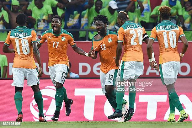 Ivory Coast's forward Wilfried Bony celebrates with teammates after scoring a goal during the 2017 Africa Cup of Nations group C football match...