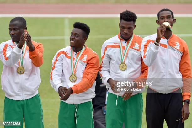 Ivory Coast's Francis Kone Gogbeu Arthur Cisse Gue Aurel Eme Tchan Bi Chan and Wilfried Serge Koffi pose with their gold medals on the podium during...