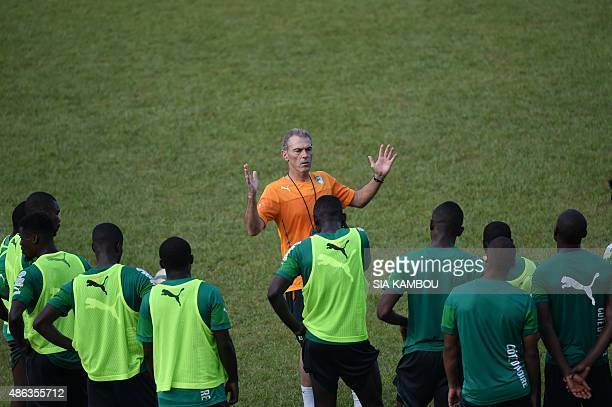 Ivory Coast's French coach Michel Dussuyer speaks to players during a training session on September 3 2015 at the Felix Houphouet Boigny stadium in...