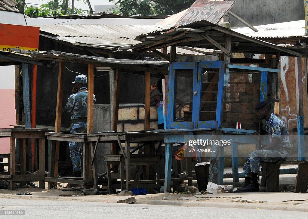 Ivory Coast's gendarmes sit at their post near the paramilitary police barracks in the Yopougon district in the west of the city of Abidjan on December 21, 2012. Armed men attacked a gendarmerie barracks in the main Ivory Coast city of Abidjan overnight, while a separate armed group attacked an army post to the north, military and UN sources said. AFP PHOTO/ SIA KAMBOU