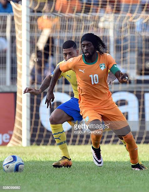 Ivory Coast's Gervinho fight for the ball with Gabon's Paulin Lloyd during the 2017 African Cup of Nations qualification football match between Ivory...