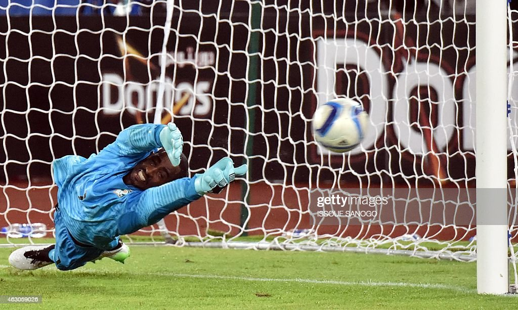 Ivory Coast's goalkeeper <a gi-track='captionPersonalityLinkClicked' href=/galleries/search?phrase=Boubacar+Barry&family=editorial&specificpeople=550738 ng-click='$event.stopPropagation()'>Boubacar Barry</a> dives and stops Ghana's last penalty during the penalty shout out of the Africa Cup of Nations final match between Ivory Coast and Ghana in Bata on Febuary 8, 2015.
