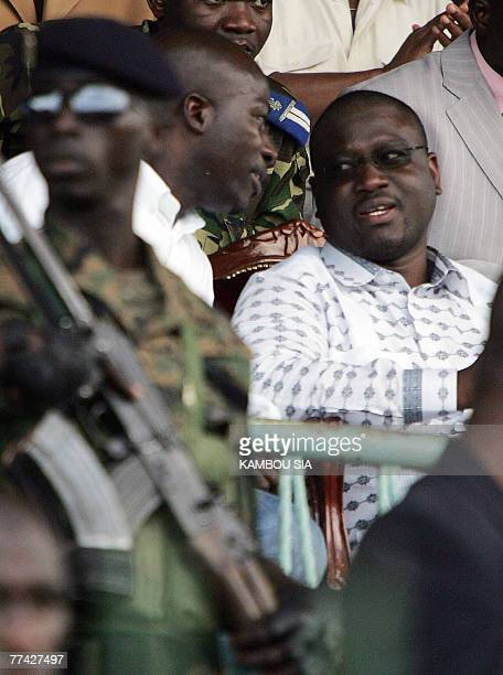 Ivory Coast's Guillaume Soro speaks with the leader of the Young Patriots Charles Ble Goude during a visit in Gagnoa 20 October 2007 AFP PHOTO /...