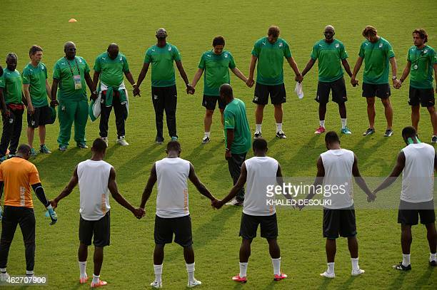 Ivory Coasts head coach Renard Herve and his players take part in a training session in Bikuy stadium in Bata on February 3 2015 Ivory Coast will...