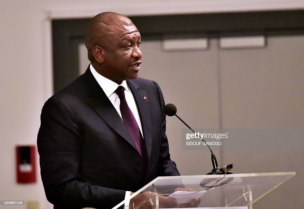 Ivory Coast's Interior Minister Ahmed Bakayoko (C) delivers his message during a security meeting of the ministers of Security Defence and Security of the West African Economic and Monetary Union zone (UEMOA) in Abidjan on May 27, 2016. / AFP / ISSOUF