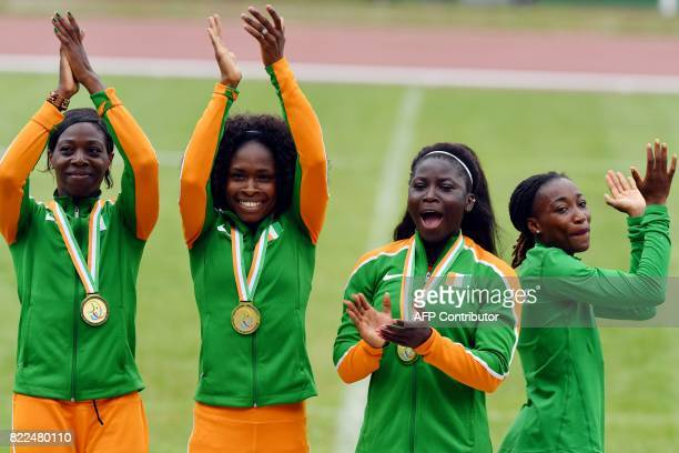 Ivory Coast's Karel Elodie Ziketh Mireille Parfaite Gaha Adeline Gouenon Nanzie and Marie Josee Ta Lou celebrate on the podium after winning the...