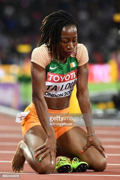 Ivory Coast's MarieJosée Ta Lou reacts after winning silver in the final of the women's 200m athletics event at the 2017 IAAF World Championships at...