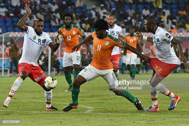 Ivory Coast's midfielder Franck Kessie challenges Democratic Republic of the Congo's midfielder Merveille Bokadi and Democratic Republic of the...
