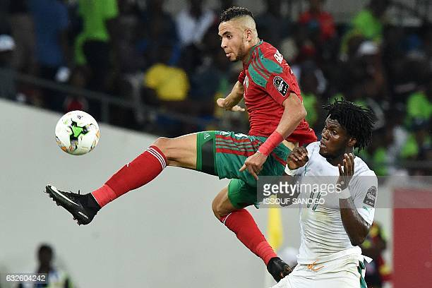 Ivory Coast's midfielder Franck Kessie challenges Morocco's forward Youssef EnNesyri during the 2017 Africa Cup of Nations group C football match...