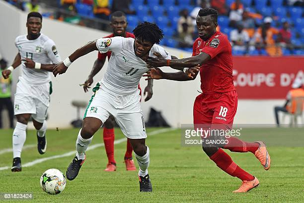 Ivory Coast's midfielder Franck Kessie challenges Togo's midfielder Lalawele Atakora during the 2017 Africa Cup of Nations group C football match...