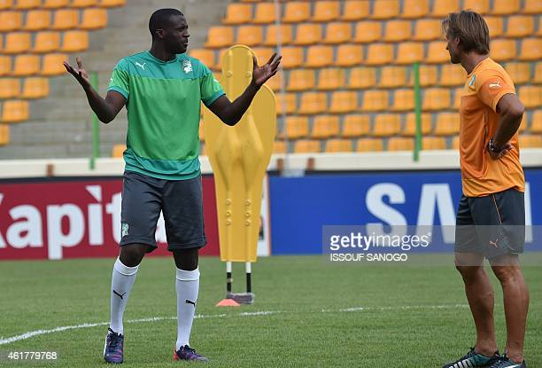 Ivory Coast's midfielder Yaya Toure speaks with his coach Herve Renard during a training session at Malabo stadium on the eve of the team's first...