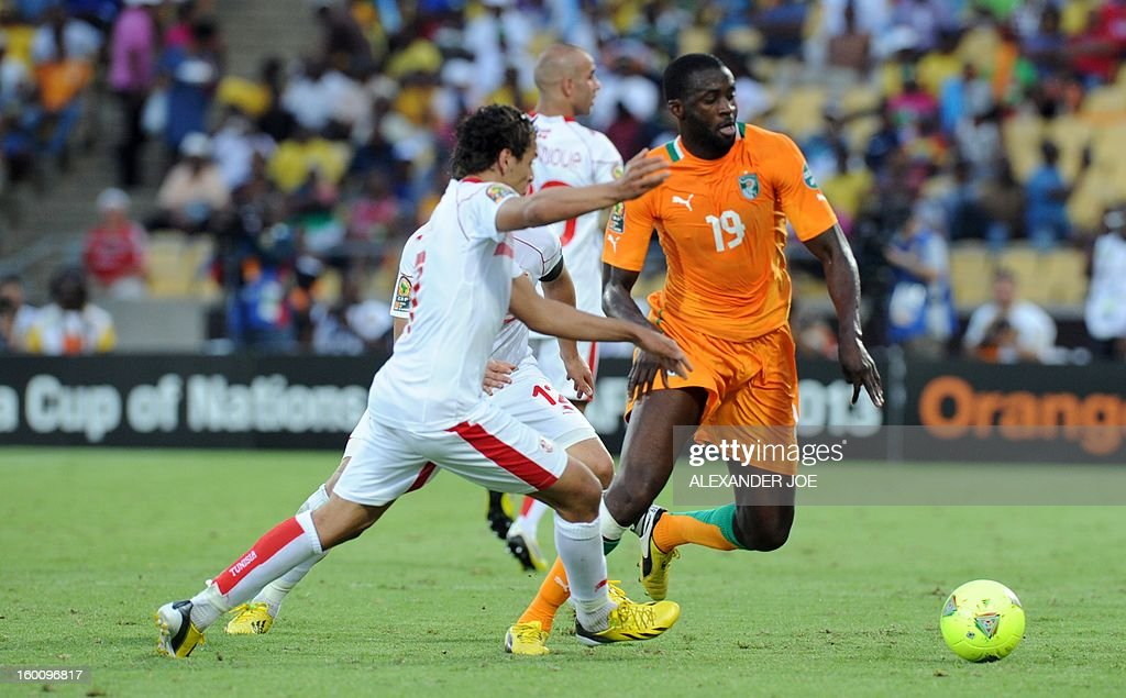 Ivory Coast's midfielder Yaya Toure (R) vies with Tunisia's midfielder Youssef Msakni during the 2013 African Cup of Nations football match Ivory Coast vs Tunisia in Rustenburg on January 26, 2013 at Royal Bafokeng Stadium. Ivory Coast won 3-0.