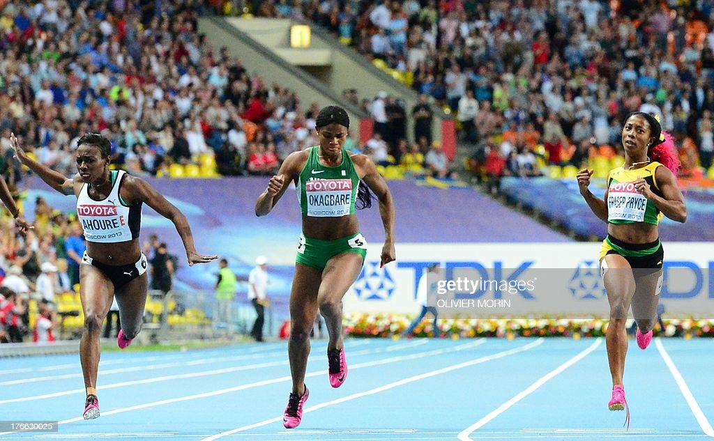 Ivory Coast's Murielle Ahoure, Nigeria's Blessing Okagbare and Jamaica's Shelly-Ann Fraser-Pryce compete during the women's 200 metres final at the 2013 IAAF World Championships at the Luzhniki stadium in Moscow on August 16, 2013.