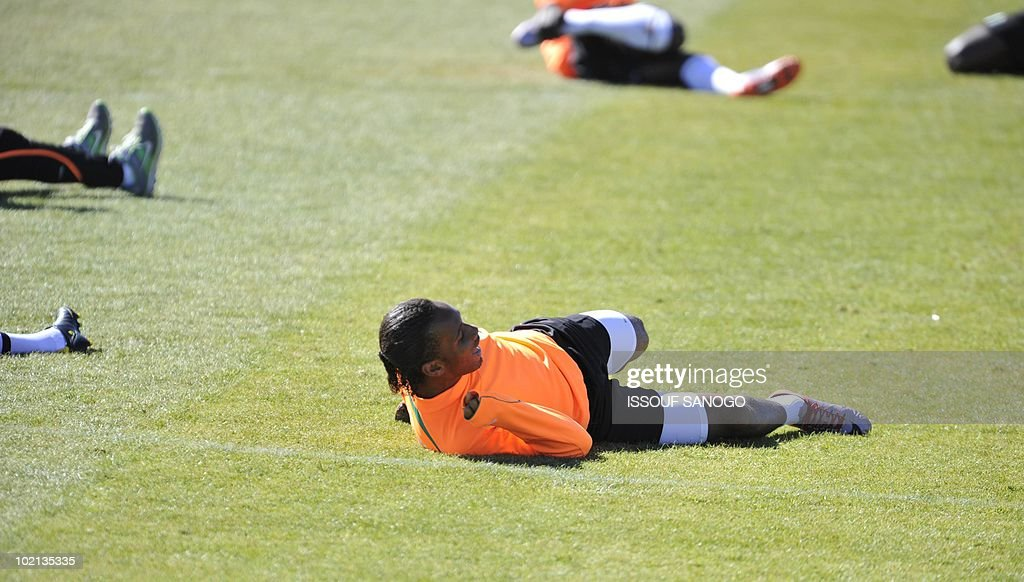 Ivory Coast's national football team captain Didier Drogba stretches during a training session on June 16, 2010 in Sharpeville, a day after their first 2010 World Cup tournament match agaisnt Portugal.