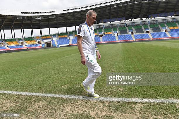 Ivory Coast's national football team coach Michel Dussyer walks on the pitch at the Oyem stadium on January 15 2017 on the eve of their 2017 Africa...