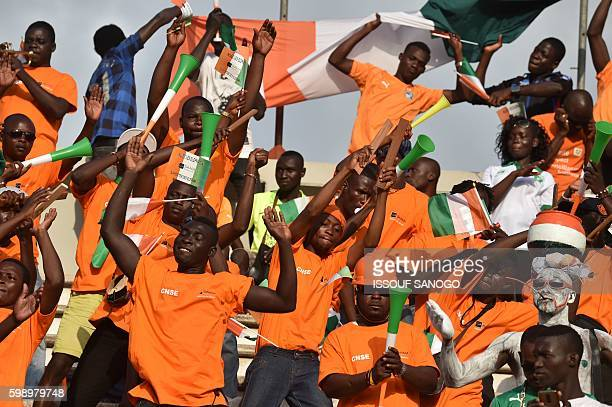 Ivory Coast's national football team fans cheer on the tribune at the stade de la paix in Bouake on September 3 2016 during their 2017 African Cup of...