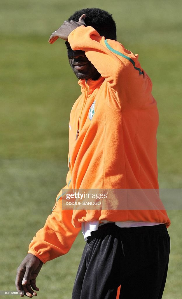 Ivory Coast's national football team palyer Habib Kolo Toure shades his eyes during a training session on June 16, 2010 in Sharpeville, a day after their first 2010 World Cup tournament match against Portugal.