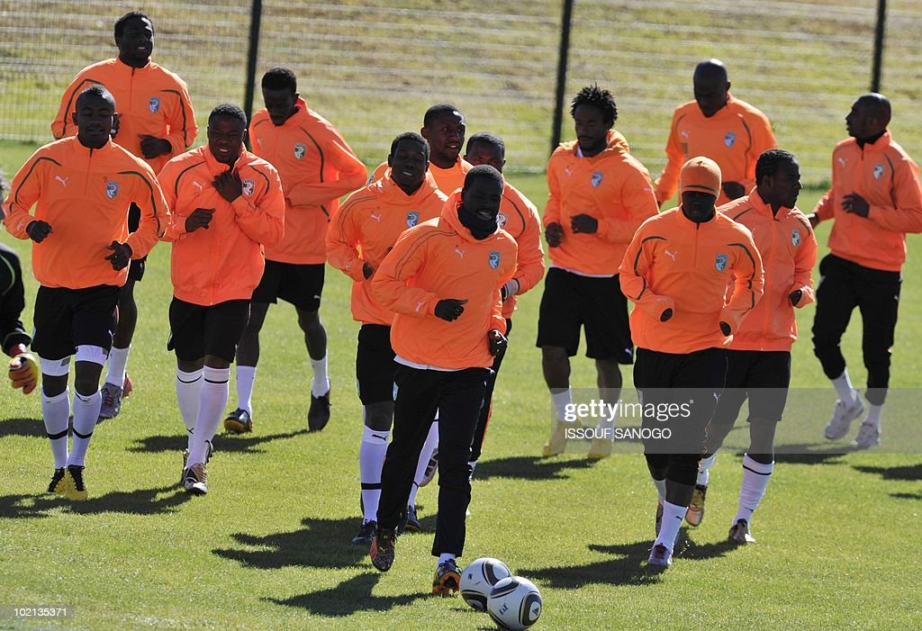 Ivory Coast's national football team players warm up during a training session on June 16, 2010 in Sharpeville, a day after their first 2010 World Cup tournament match agaisnt Portugal.