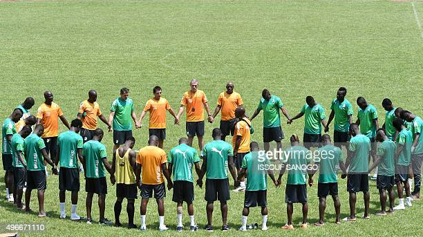 Ivory Coast's national team players and coaches attend a training session at the Felix HouphouetBoigny stadium in Abidjan on November 11 2015 ahead...