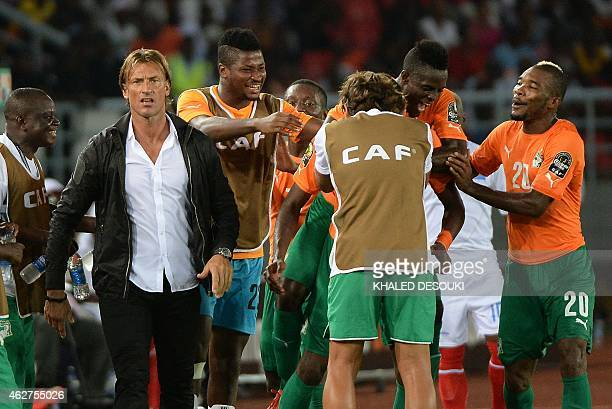 Ivory Coast's players and coach Herve Renard celebrate after scoring a third goal during the 2015 African Cup of Nations semifinal football match...