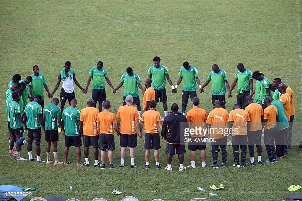 Ivory Coast's players and staff members gather during a training session on September 3 2015 at the Felix Houphouet Boigny stadium in Abidjan prior...