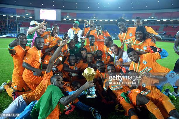 Ivory Coast's players celebrate with the trophy at the end of the 2015 African Cup of Nations final football match between Ivory Coast and Ghana in...