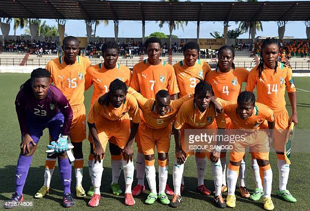 Ivory Coast's players pose before a women friendly football match between Cameroon and Ivory Coast on May 10 2015 at the Robert Champroux stadium in...