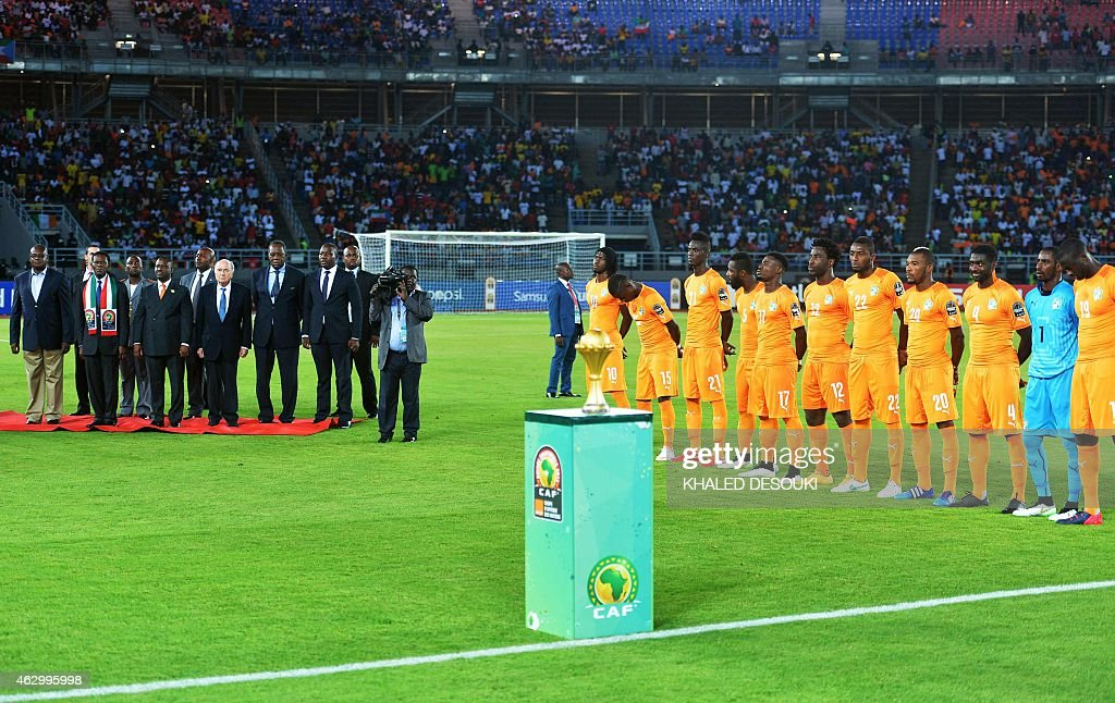 Ivory Coast's players pose near the trophy as Equatorial Guinea's President <a gi-track='captionPersonalityLinkClicked' href=/galleries/search?phrase=Teodoro+Obiang+Nguema+Mbasogo&family=editorial&specificpeople=743220 ng-click='$event.stopPropagation()'>Teodoro Obiang Nguema Mbasogo</a> (2nd-L), FIFA president <a gi-track='captionPersonalityLinkClicked' href=/galleries/search?phrase=Sepp+Blatter&family=editorial&specificpeople=209372 ng-click='$event.stopPropagation()'>Sepp Blatter</a> (4th-L), Ivory Coast's Parliament Speaker <a gi-track='captionPersonalityLinkClicked' href=/galleries/search?phrase=Guillaume+Soro&family=editorial&specificpeople=697567 ng-click='$event.stopPropagation()'>Guillaume Soro</a> (3rd-L) and Confederation of African Football president <a gi-track='captionPersonalityLinkClicked' href=/galleries/search?phrase=Issa+Hayatou&family=editorial&specificpeople=541876 ng-click='$event.stopPropagation()'>Issa Hayatou</a> (5th-L) listen to the teams' national anthems ahead of the 2015 African Cup of Nations final football match between Ivory Coast and Ghana in Bata on February 8, 2015. AFP PHOTO / KHALED DESOUKI