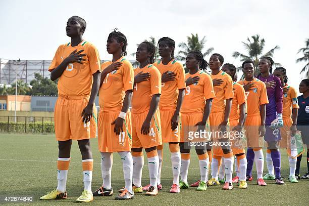 Ivory Coast's players sing their national anthem before a women friendly football match between Cameroon and Ivory Coast on May 10 2015 at the Robert...