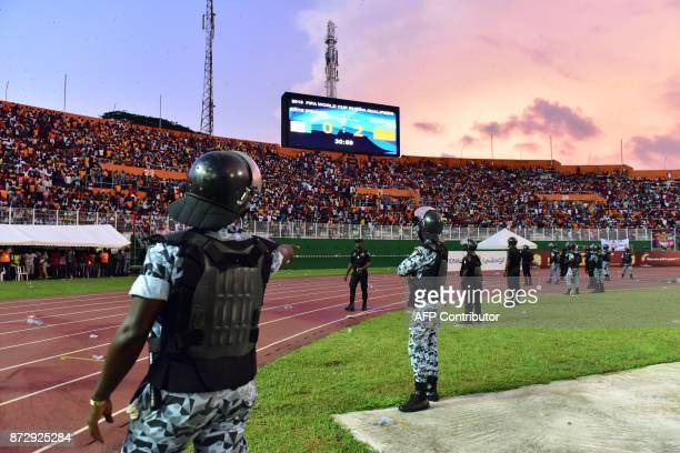 Ivory Coast's police officers secure the pitch at the Felix HouphouetBoigny stadium in Abidjan on November 11 at the end of the FIFA World Cup 2018...